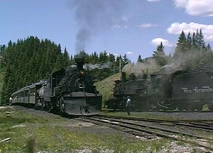 487 leaves Cumbres, whistling for the highway crossing. June 2000.