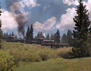 487 and 488 crossing old highway trestle at Cumbres, June 1997